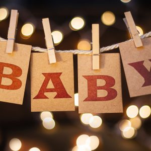 Unique baby nursery decorating ideas using wood wall and ceiling treatments by T&G Flooring in Denver and Evergreen